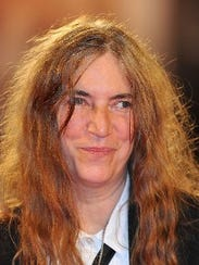 Patti Smith will induct the late Lou Reed into the