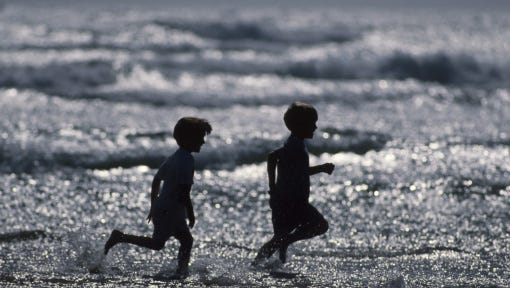 Two Children Running at the Beach