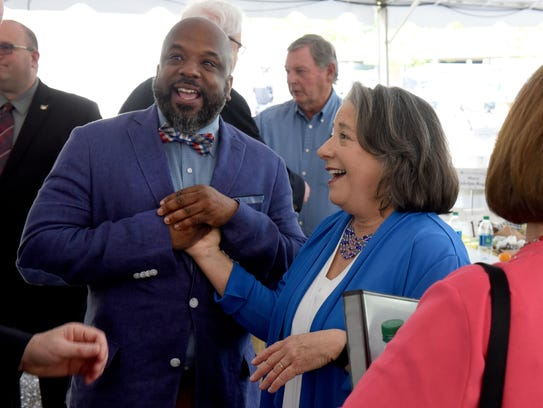 Rep. Rick Staples presented a $100,000 from the state to the Knoxville Area Urban League. Staples, left, jokes with Mayor Madeline Rogero before she presented her proposed 2018-19 budget on April 27 at the Mary Costa Plaza.