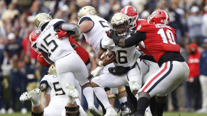 Georgia Tech quarterback TaQuon Marshall (16) is sacked in the second half of an NCAA college football game between Georgia and Georgia Tech in Athens, GA, on Saturday, Nov. 24, 2018.