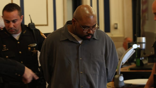 Glen Bates enters the courtroom ahead of being found guilty of murdering his 2-year-old daughter.