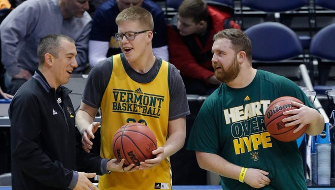 Vermont forward Josh Speidel (32)talks with team personnel during practice before the first round of the NCAA Division I Men's Basketball Championship Wednesday, March 15, 2017 at the BMO Harris Bradley Center in Milwaukee, Wis. Speidel is recovering from a traumatic brain injury suffered in a car crash in 2015.