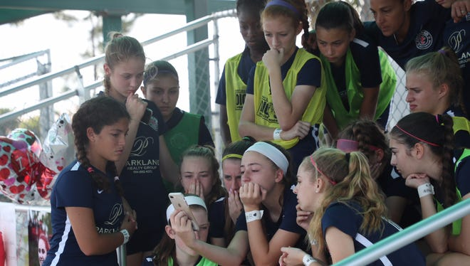 The soccer teammates of Alyssa Alhadeff listen to the live stream of her mother as she speaks about her daughter and gun violence. The team practiced on Saturday, Feb. 17, 2018. The practice offers an outlet for the team, said Laurie Thomas, coach of the Parkland Soccer Club.