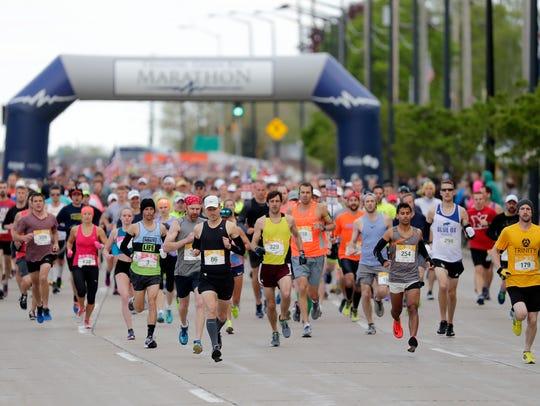 Runners start the Cellcom Green Bay Marathon on Sunday,