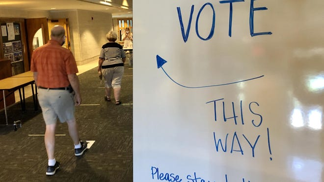 Voters cast their ballots in Ottawa County Tuesday, Aug. 4.