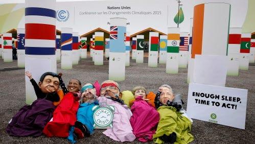 Demonstrators impersonate world leaders Dec. 10, 2015, at the U.N. talks outside Paris.