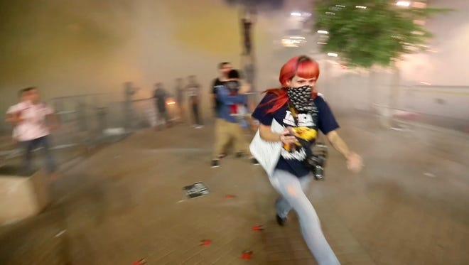 Phoenix police used tear gas on protesters outside the Phoenix Convention Center after President Donald Trump's speech on Aug. 22, 2017.