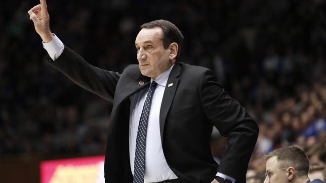 Duke head coach Mike Krzyzewski directs his players against North Carolina State during the first half of an NCAA college basketball game in Durham, N.C., Monday, March 2, 2020.