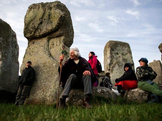 Revelers participate in the summer solstice gathering at Stonehenge, Salisbury, Britain on June 21, 2018.