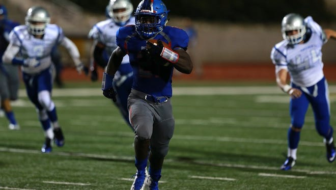 Americas running back Josh Fields sprints away from Carlsbad defenders for a long gain.