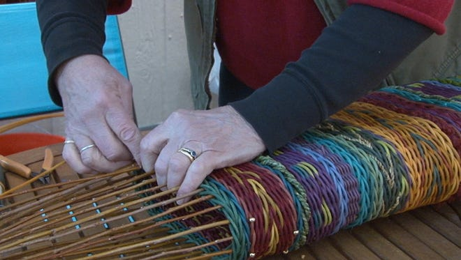Marilyn Stevens, a weaver from Montana, works on her craft at the Scottsdale Celebration of Fine Art.