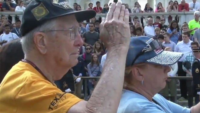 Sun City West resident Jim Mende, a World War II veteran, salutes during the changing of the guard ceremony at Arlington National Cemetery's Tomb of the Unknown Soldier,
