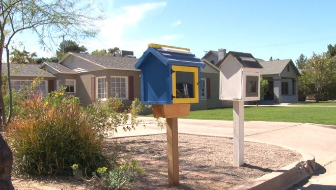 Two Little Free Libraries are displayed in front of homes in Phoenix.