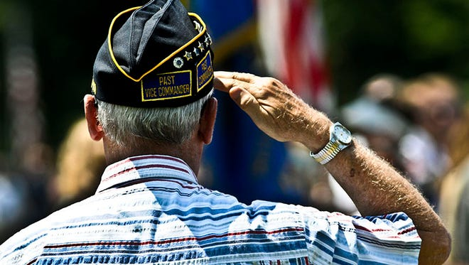 An Army veteran salutes the flag during a Memorial Day ceremony. Experts say Veterans Treatment Courts can help troubled vets stay out of jail by treating underlying problems they may have.