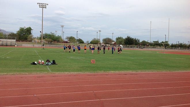 The Apache Junction High School band practices after school on a Friday afternoon. School administrators said activities such as football and band practice have not been affected by a four-day school week with school closed on Friday.