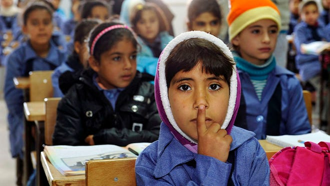 Displaced Syrian children in a classroom at a Jordanian refugee camp in January 2012 that housed tens of thousands of refugees.