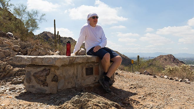 Stephen Nally takes a break on the Nature trail in the Phoenix Mountains Preserve.