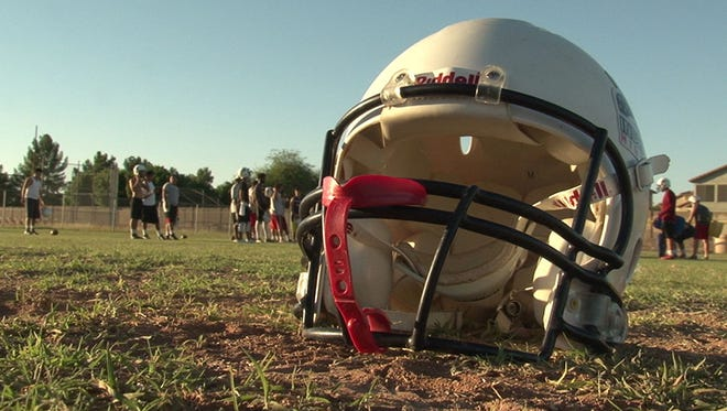 Football helmets are often the only protection for a high school football player against a serious concussion.
