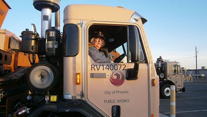 A Phoenix worker drives one of the trucks that is taking in data to help analyze what will lead to less trash by 2050.