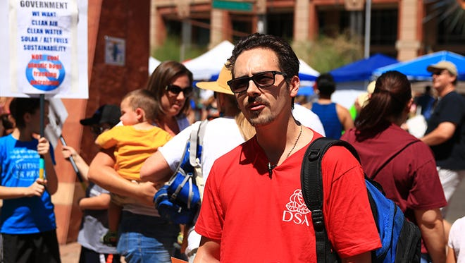 Phoenix Democratic Socialists of America member Trevor Keeley attended the March for Science with other DSA members.