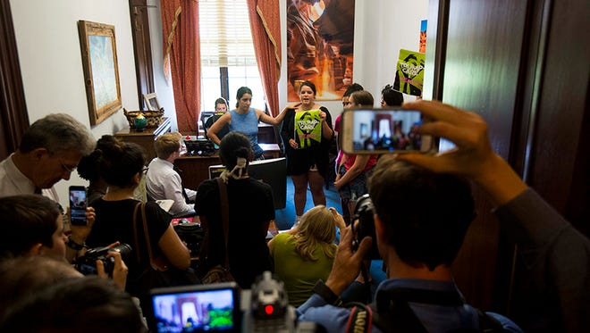 Protesters take over the Capitol Hill office of Sen. Jeff Flake, R-Arizona, one of several lawmakers being targeted by opponents of a Senate proposal to replace the Affordable Care Act, or Obamacare.