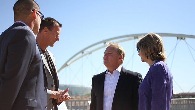 City Councilman Joel Navarro (from left); Rolf Halden, director of the Biodesign Center for Environmental Health Engineering at Arizona State University; Mayor Mark Mitchell and City Councilwoman Lauren Kuby discuss the funding and plans for the opioid wastewater partnership between ASU and Tempe.