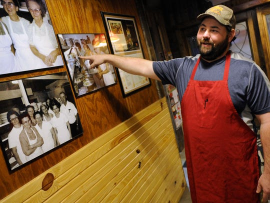 Owner Kerry Goetz points to the manual french-fry maker