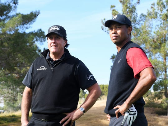 Tiger Woods and Phil Mickelson look on prior to The Match: Tiger vs Phil at Shadow Creek Golf Course on November 23, 2018 in Las Vegas, Nevada.  (Photo by Harry How/Getty Images for The Match)