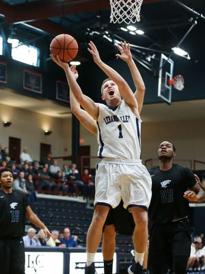 Sam Light, of Lebanon Valley College, goes up for a shot during a 58-53 win over Wesley College in the championship game of the Rinso Marquette Tournament at LVC, on Sunday, Light scoreca game-high 26 points on the way to earning tournament MVP honors.