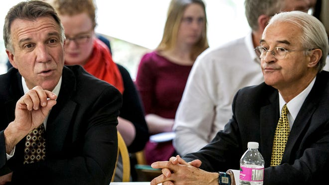 Attorney General William Sorrell, right, listens as Lt. Gov. Phil Scott testifies before the Senate Government Operations Committee at the Statehouse in Montpelier on Tuesday, April 28, 2015. The committee is considering several issues pertaining to public campaign financing and whether or not the AG's office should investigate itself.
