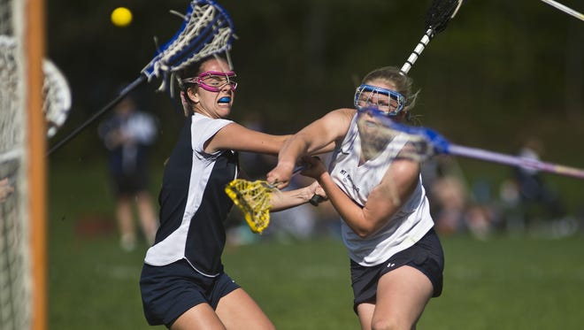 MMU's #11Karin Rand fire a shot for one of many goals during the Cougars girl's lacrosse game in Jericho against Essex Wednesday afternoon, May 13, 2015.