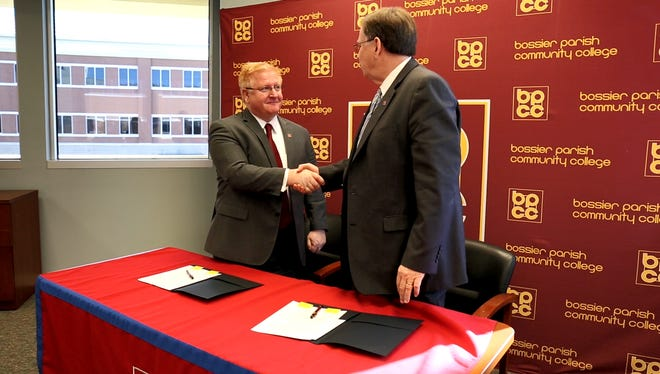 BPCC Chancellor Dr. Rick Bateman Jr. (left) and Louisiana Tech University President Dr. Les Guice shake hands after signing the MOU allowing full-time BPCC employees who wish to enroll at Louisiana Tech University to receive reduced tuition benefits.