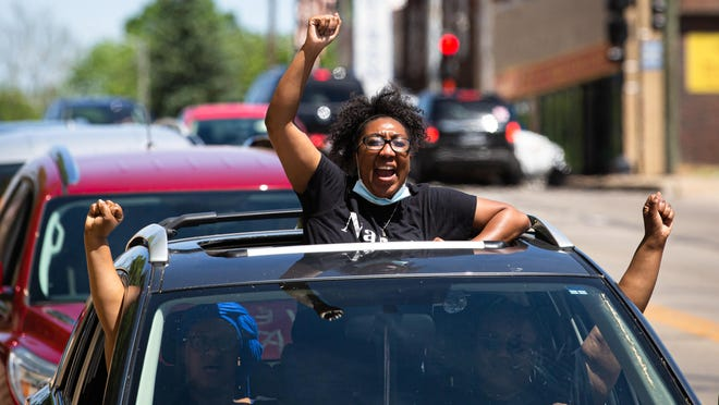 """Erica Austin chants """"No Justice, No Peace"""" from the sunroof of a car driving down South Grand Avenue during the Solidarity Vehicle Procession hosted by Black Lives Matter Springfield, Sunday, May 31, 2020, in Springfield, Ill. """"Black lives do matter and enough is enough,"""" said Austin. """"We want equal rights, we want the cops to stop killing us because we are humans."""" The procession was in response to the deaths of Breonna Taylor, Dreasjon Reed and George Floyd, all of whom were killed by law enforcement officers."""