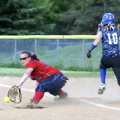 Binghamton first baseman Elana Shelepak awaits a throw that beats Kendal Cook of Horseheads to the bag during Saturday's Section 4 Class AA title game at BAGSAI Complex. Binghamton won, 15-1.