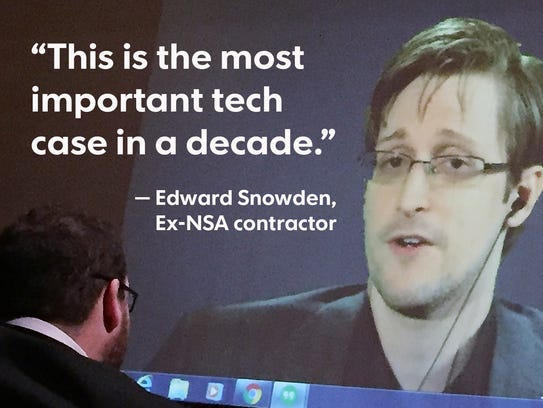 Edward Snowden speaks via video conference to people