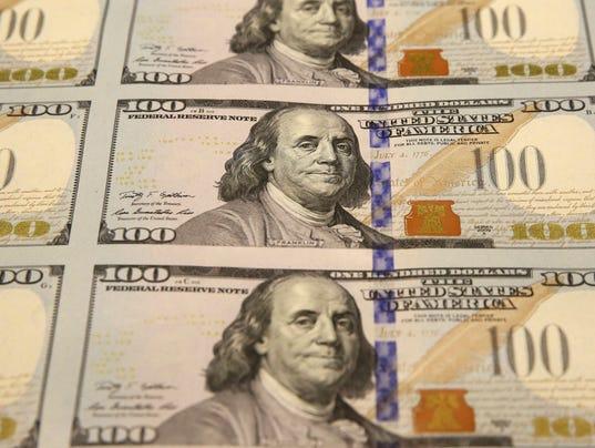 AP_NEW_$100_BILLS_59003440