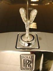 A Spirit of Ecstasy hood ornament from a Rolls-Royce Phantom.