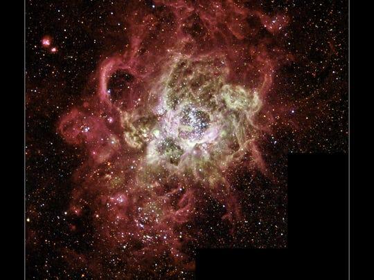 Image of stellar nursery NGC 604, where star systems