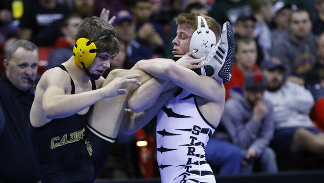 Stratford's Jeremy Schoenherr, right, sweeps the leg of Cadott's Brady Spaeth during their Division 3 138-lb semifinals match during the WIAA Individual Wrestling State Tournament Friday, February 24, 2017, at the Kohl Center in Madison, Wis. T'xer Zhon Kha/USA TODAY NETWORK-Wisconsin