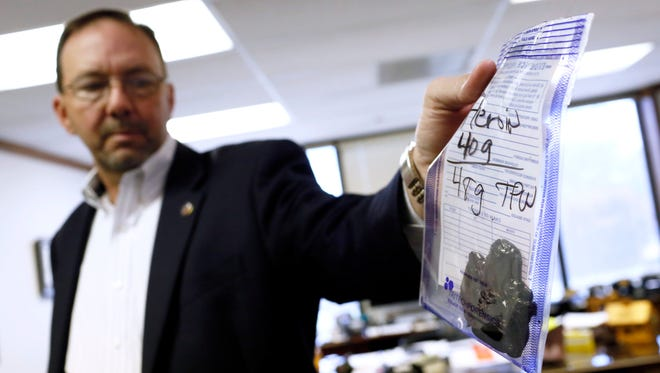 Mississippi Bureau of Narcotics Director John Dowdy Jr., shown here in this 2017 file photo holding an evidence bag of 40 grams of black tar heroin, is the focus of a state auditor probe into whether he misused state property.