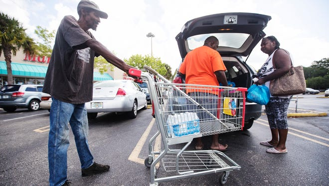 Charleston Park resident Linda Francis, right, shops with former Charleston Park resident, Willie McGee, left, last year. Francis checked in on and helped McGee with transportation and other issues.