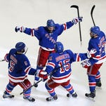 May 29, 2014; New York, NY, USA; New York Rangers center Dominic Moore (28) celebrates his goal with teammates during the second period against the Montreal Canadiens in game six of the Eastern Conference Final of the 2014 Stanley Cup Playoffs at Madison Square Garden. Mandatory Credit: Adam Hunger-USA TODAY Sports ORG XMIT: USATSI-180996 ORIG FILE ID:  20140529_pjc_sh4_074.JPG
