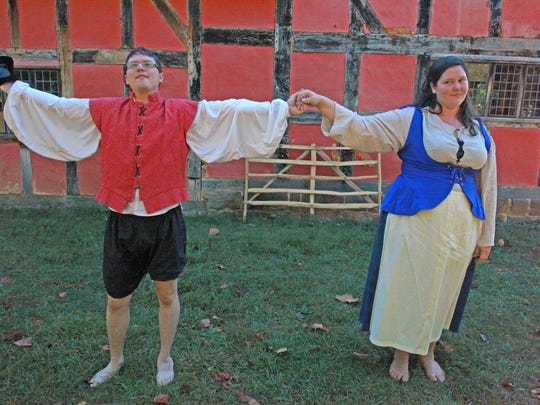 "Mary Baldwin MFA students Marshall Garrett and Molly Harper act out the wooing scene in Shakespeare's ""Taming of the Shrew"" outside the 1600s English Farm at Frontier Culture Museum's Folkways Festival on Sept. 19, 2015."