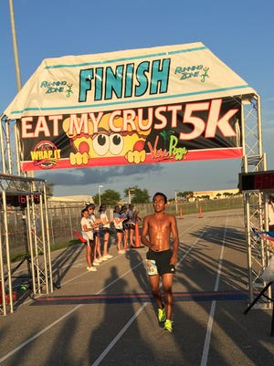 Jonathan Campbell takes first place in the 2016 Eat My Crust 5k race in Viera.