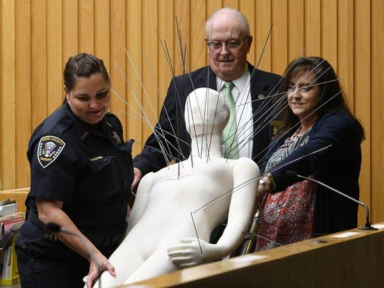 Courtroom staff Tonya Coker, left, Dennis Bowman, and