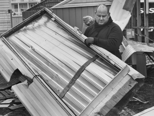 Frank Meola of Meola Demoliton and House Cleanout takes apart one of the mobile homes being removed from the Long