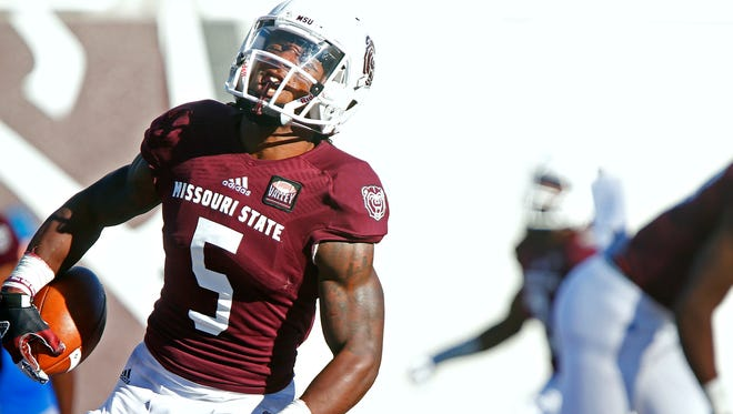 Missouri State Bears wide receiver Deion Holliman (5) celebrates after running back a punt return for a touchdown during third quarter action of the Bears' game against the Indiana State Sycamores at Robert W. Plaster Stadium in Springfield, Mo. on Oct. 3, 2015. Indiana State won the game 56-28.