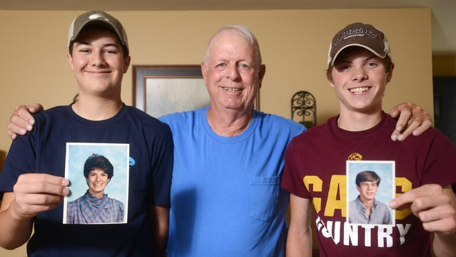 Jerry Wade and his grandsons Brayden Beardsley, 15, left, holding a picture of his mother Lynn, and Andy Wade, right, holding a picture of his father Greg. Jerry unintentionally influenced the paths his children followed, and is now inspiring his grandchildren.