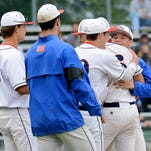 Teammates hug and surround Mason pitcher Harrison Kinney (6) after he struck out Portland's Austin Allison to close out the 3-2 victory in the Diamond Classic matchup Wednesday, May 20, 2015 at Lansing's Kircher Municipal Park. Allison quieted a Portland seventh-inning rally with the strikeout.