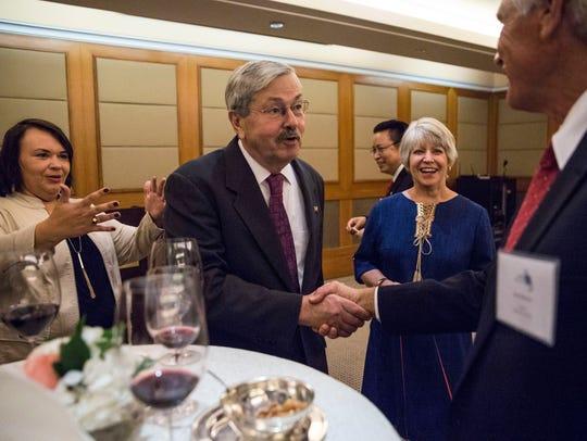 U.S. Ambassador to China Terry Branstad shakes hands